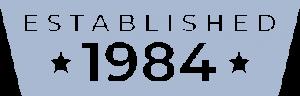 "light blue icon that says ""established 1984"""
